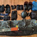 snowboarding gear flat lay